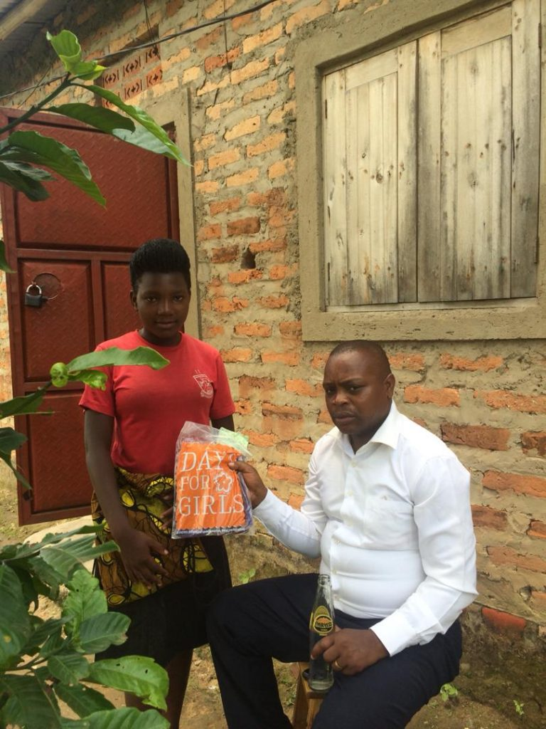 Olivia presents a local reverend with an MHM kit